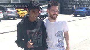 Lionel con Willian en Barcelona