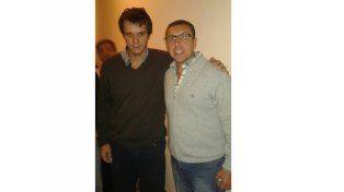 Amaro (de anteojos) junto a Enrique Cresto.