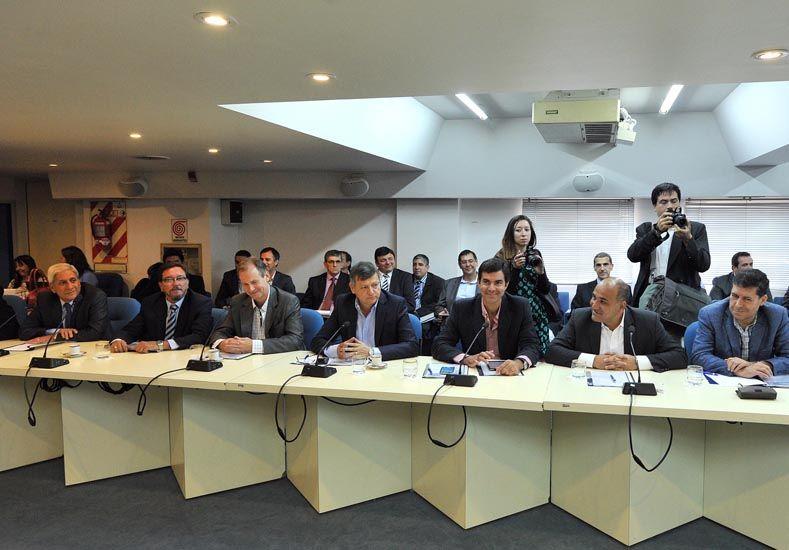 Mandatarios. Bordet estuvo el miércoles en el CFI junto al senador entrerriano Pedro Guastavino.