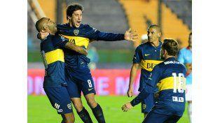 Pérez festeja su gol. Fotos: Télam y NA
