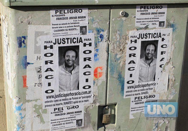 Símbolo. El rostro de Horacio -hijo- empapela las paredes como emblema del reclamo por justicia.   Foto UNO/Diego Arias