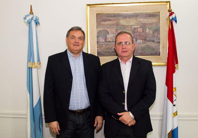 Abordaje. García y Schneider tuvieron una reunión de trabajo.