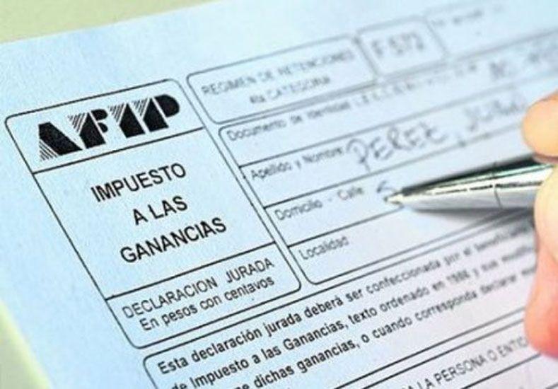 Finalmente, el medio aguinaldo tributará Ganancias y luego la AFIP definirá cómo se devuelve
