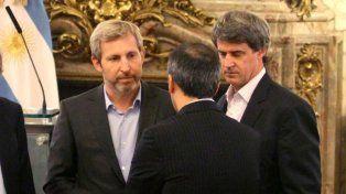 Interlocutores. Los ministros Prat-Gay y Frigerio negocian con las provincias por la deuda.