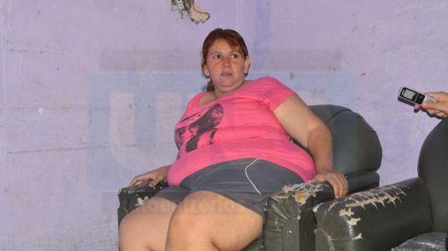 Víctima. Olga hablaba por teléfono con su hijo en la vereda cuando pasó una moto y le dispararon.