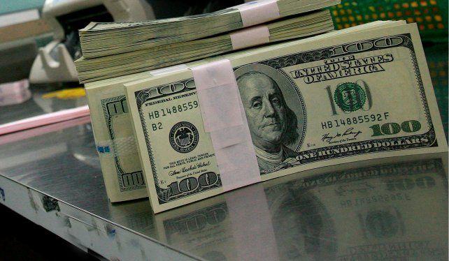 El dólar cayó a $58,06 pesos