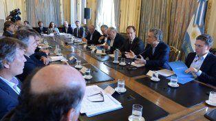 Producción forestal. El gobernador se sentó al lado de Macri en la reunión en Buenos Aires.