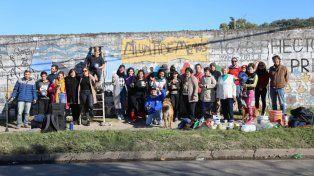 La comunidad restauró el mural en un paredón de Sportivo.