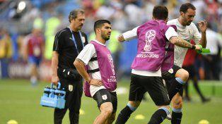 Jugadores de Uruguay haciendo movimientos precompetitivos.