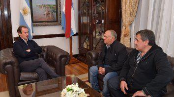 Bordet, Osuna y Cáceres en la reunión.