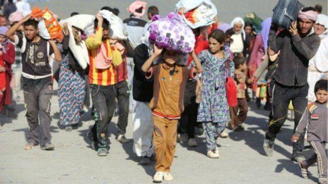 Muchos yazidíes tomaron refugio en el cercano monte Sinjar