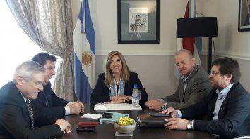 Romero con los senadores Ferrari, Kisser, Piana y Schild.