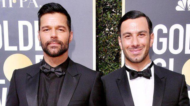 Ricky junto a su esposo Jwan.