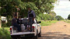 La policía de Corrientes custodia a uno de los detenidos.