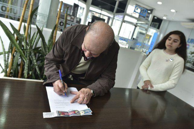 La firma del convenio con <b>UNO</b>.