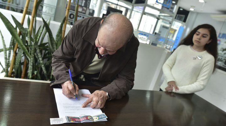 La firma del convenio con UNO.