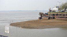 el rio sigue bajando y desnuda la costa de parana