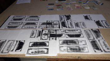 en allanamiento por robo encontraron impresora y dolares falsos