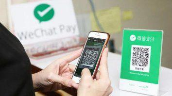 La futura moneda virtual estaría asociada a medios de pago electrónicos (WeChat, AliPay...) que los chinos usan ya en sus teléfonos para pagar la mayoría de sus compras.