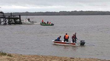 hallaron el cuerpo del joven que se habia arrojado al rio uruguay